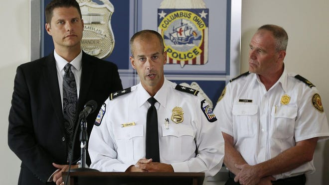 Columbus Police Deputy Chief Ken Kuebler, center, speaks at a news conference in 2016 with Columbus City Council President Zach Klein, left, and Columbus Division of Fire Deputy Chief Jim Davis.