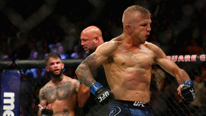 TJ Dillashaw reacts during his UFC bantamweight title bout against Cody Garbrandt during the UFC 217 event at Madison Square Garden on Nov. 4, 2017.