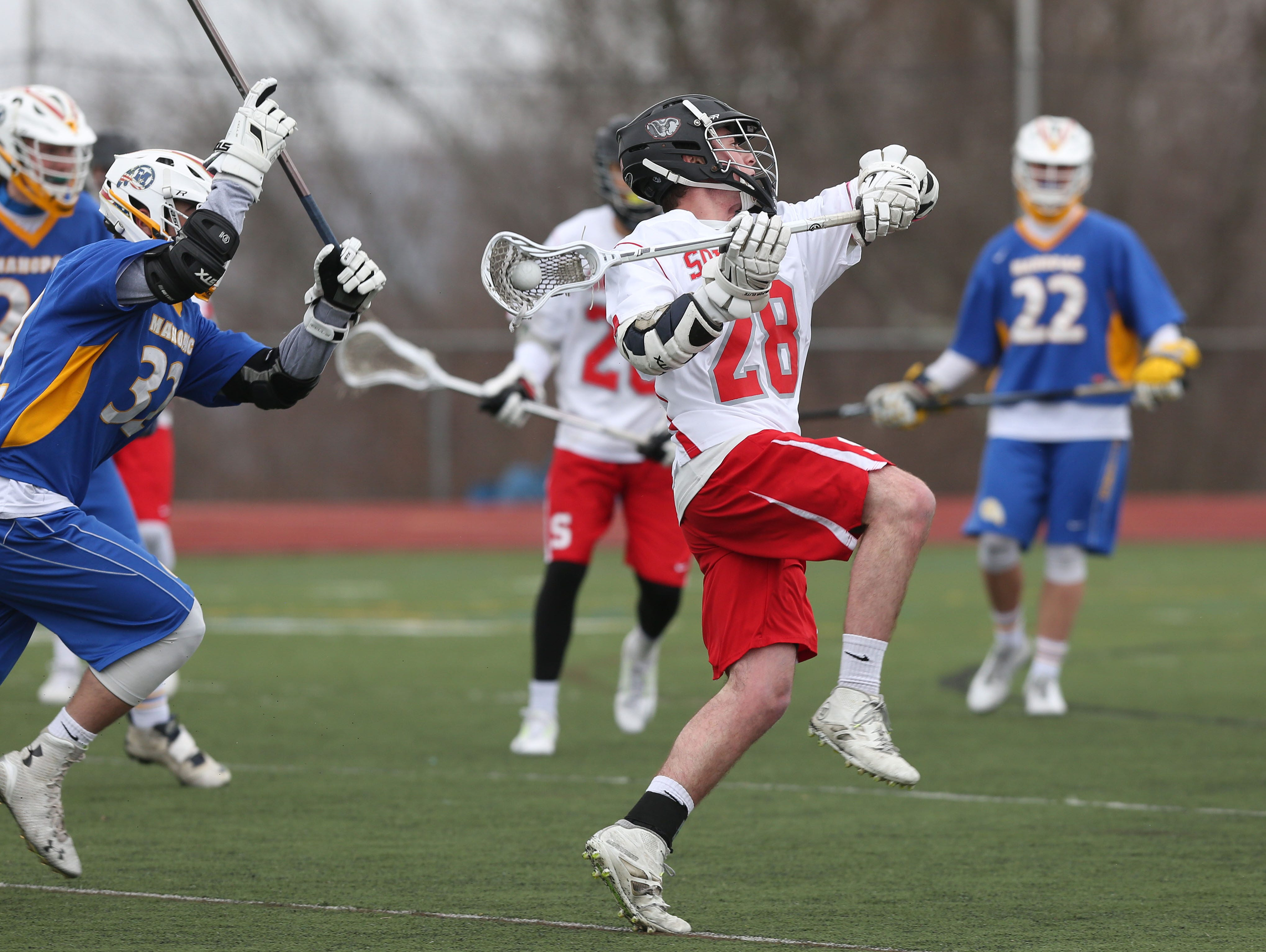 Somers' Andrew Lowman (28) fires a shot on goal against Mahopac during a boys lacrosse game at Somers High School April 9, 2016. Somers won the game 8-7.