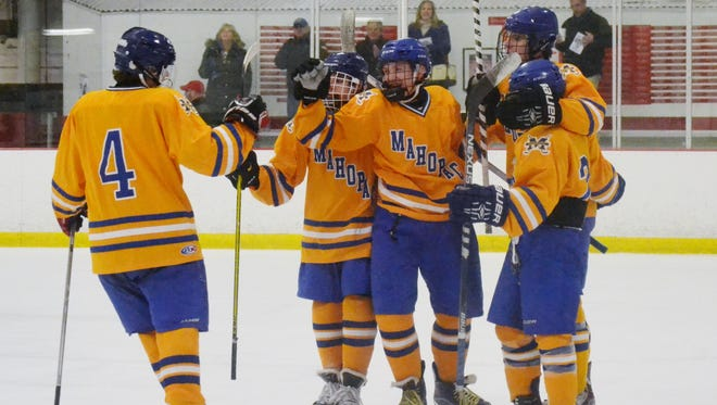 Mahopac celebrates after T.J. McKee scored a first-period goal against John Jay on Saturday at Brewster Ice Arena.