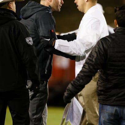Iowa State head coach Matt Campbell, right, greets
