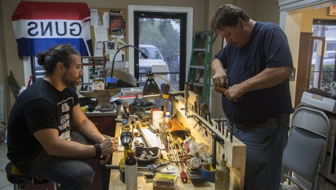 In traditional fashion of master schooling apprentice, Master gunsmith Mark Raines offers his technique for grinding down an epoxied forend for a shotgun as apprentice Rob Scavone observes.