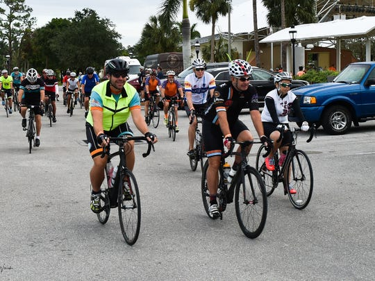 Cyclists takeoff for the 20 mile route during the Irma Relief Ride sponsored by Naples Velo at Riverside Park in Bonita Springs, Saturday October 28.   John M. Wissocki / Correspondent.