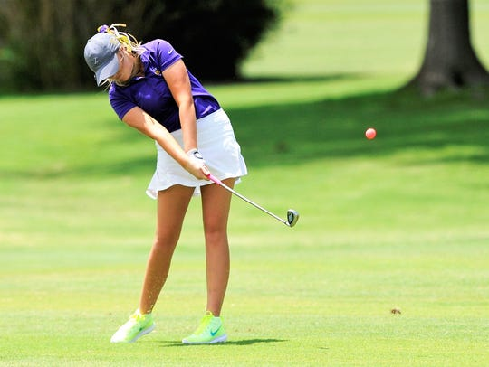 Wylie's Arin Zachary hits a shot during the first round of the UIL Class 4A state tournament at the Slick Rock Golf Course at Horseshoe Bay in Marble Falls on Monday. Zachary is in sixth place after shooting a first-round 78.