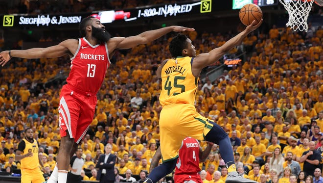 May 6: Donovan Mitchell goes up for a layup past James Harden in Game 4.