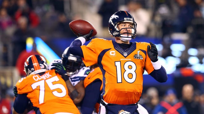 Denver Broncos quarterback Peyton Manning throws a pass against the Seattle Seahawks in the third quarter in Super Bowl XLVIII at MetLife Stadium.