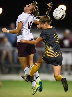 Henderson's Katie Bickers (left) and Greenwood's Anna Haddock try to control the ball in the air as the Henderson County Lady Colonels play the Greenwood Gators at Colonel Field Monday, October 3, 2016.