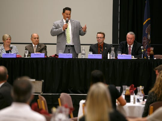 St. George City Council incumbent candidate Jimmie Hughes addresses the audience during a debate at the St. George Chamber of Commerce luncheon on the campus of Dixie State University.