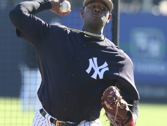 Luis Severino pitches during a early morning workout.
