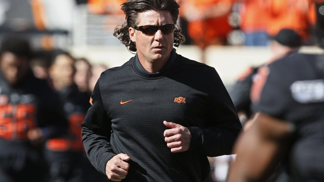 Oklahoma State coach Mike Gundy drew the ire of star running back Chuba Hubbard and others in the Cowboys locker room when he was photographed in a T-shirt bearing the image of a right-wing news network.