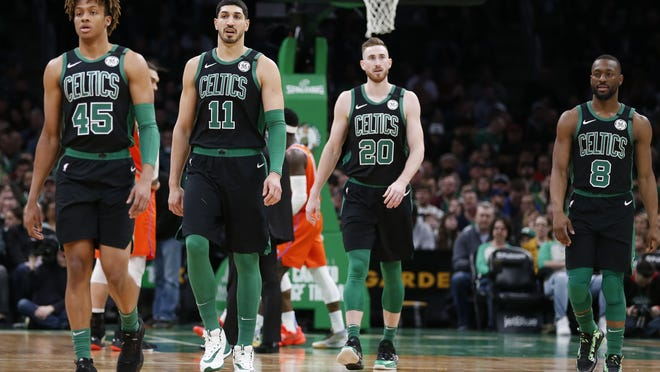 Boston Celtics players Romeo Langford (45), Enes Kanter (11), Gordon Hayward (20) and Kemba Walker (8) walk to the bench during a March 8 game against the Oklahoma City Thunder in Boston.