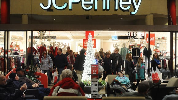 Shoppers mill about in front of JCPenney at  the Empire