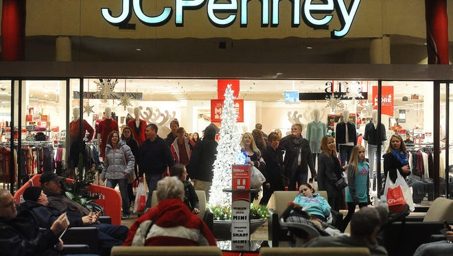 Shoppers mill about in front of JCPenney at  the Empire Mall this winter.