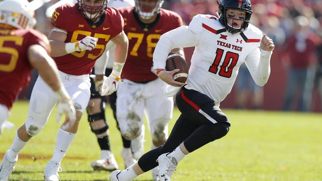 Texas Tech quarterback Alan Bowman tries to elude Iowa State defenders during the Red Raiders' 40-31 loss two years ago to the Cyclones. Bowman is questionable with an injured right ankle as the Red Raiders prepare to call on Iowa State again on Saturday.