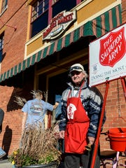 Charlie Behrens mans the Salvation Army red kettle outside of the Lebanon Farmers Market Wednesday, November 25, 2015. Behrens has been ringing the bell for 20 years.