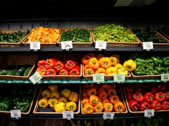 A display of peppers at Clifton Market grocery store in the Clifton neighborhood of Cincinnati on Tuesday, Aug. 29, 2017.