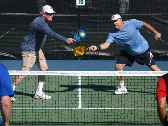 Dave Davidson, left, and his doubles partner Greg Conn