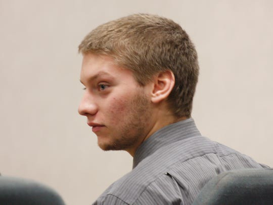 Former Milton High football player Colby Darling listens in court Tuesday as prosecutor T.J. Donovan outlines the details of the hazing scandal involving teammates. Darling pleaded guilty to simple assault.