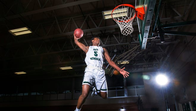 Kendrick Gray of Rice Memorial High School dunks the ball in South Burlington on Monday, April 27, 2015.