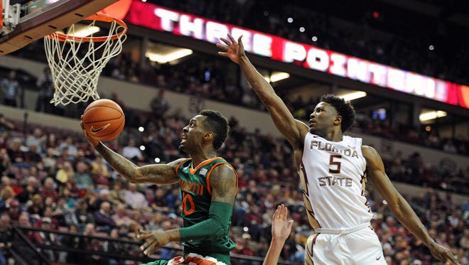 Sheldon McClellan drives to the basket for two points as Malik Beasley defends. McClellan led Miami with 20 points on the night.