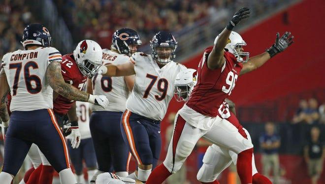Cardinals' Kareem Martin (96) reacts after sacking Bears' Mark Sanchez (6) during the third quarter at University of Phoenix Stadium in Glendale, Ariz. on August 19, 2017.