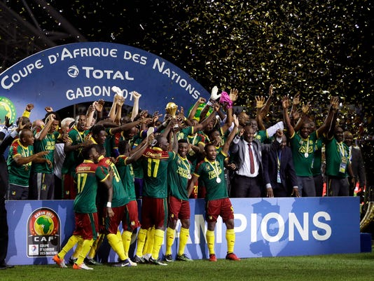 Cameroon players celebrate with the trophy after winning the African Cup of Nations final soccer match between Egypt and Cameroon at the Stade de l'Amitie, in Libreville, Gabon, Sunday, Feb. 5, 2017. Cameroon won 2-1. (AP Photo/Sunday Alamba)