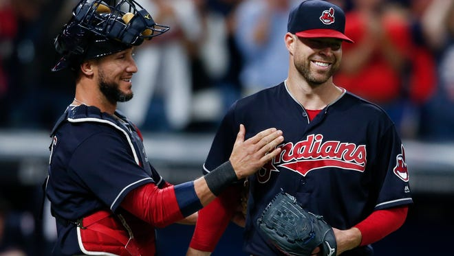 Indians starting pitcher Corey Kluber, right, and catcher Yan Gomes celebrate after the Tigers' 2-0 loss to the Indians on Tuesday, Sept. 12, 2017, in Cleveland.