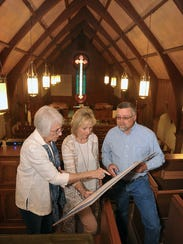LuAnne Black, Laura Slover and Todd Smith look over
