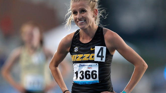 Missouri's Karissa Schweizer smiles after winning the women's 5,000-meter run at the Drake Relays on April 26, 2018, in Des Moines, Iowa.