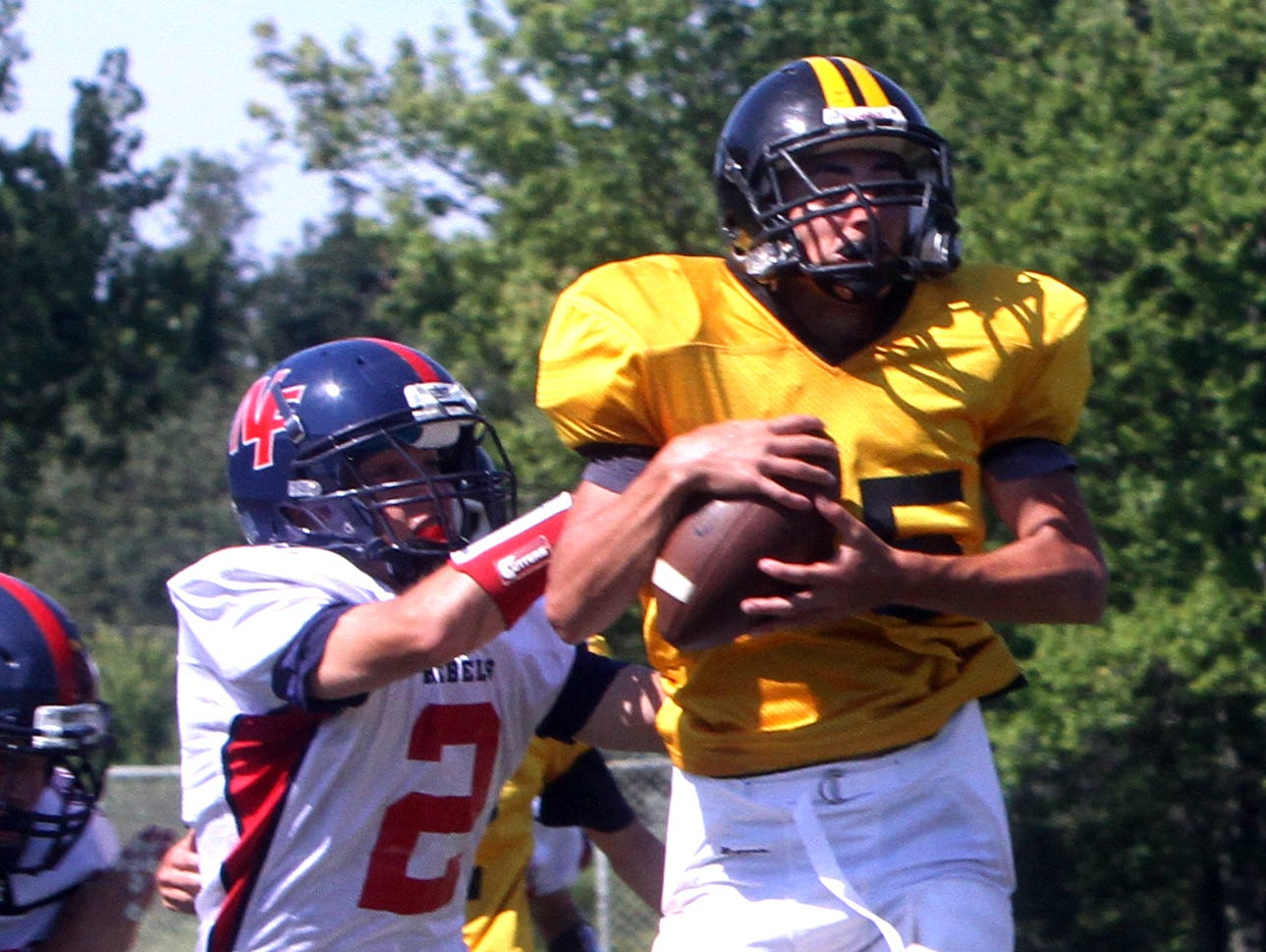 Nanuet's Mike Zaro catches a touchdown pass over a New Fairfield. Conn., defender during a multi-teamscrimmage at Brewster High School Saturday.