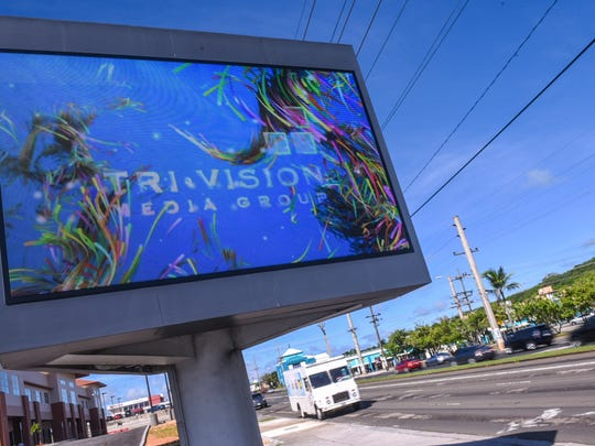 Motorists drive pass an electronic LED billboard along Marine Corps Drive near the ITC intersection in Tamuning in this July 25, 2017, file photo. A new bill would allow large digital signs to be placed on most buildings in Tumon Bay.