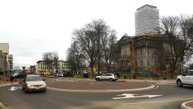 Cars progress through the roundabout at the corner of South Third Street and South Park Place.