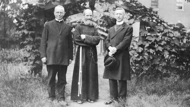 Fr. Solanus Casey is pictured here with his two brothers who were priests in 1924.
