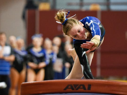 Sartell's Emma Schwartz competes on the  vault during the team Class A championships Friday, Feb. 23, at the Maturi Pavilion in Minneapolis.