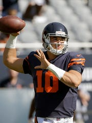 FILE - In this Sept. 24, 2017, file photo, Chicago Bears quarterback Mitchell Trubisky (10) warms up before an NFL football game against the Pittsburgh Steelers, in Chicago. The Chicago Bears are set to unveil their prized rookie quarterback on Sunday, Oct. 8 against the Minnesota Vikings. (AP Photo/Nam Y. Huh, File)