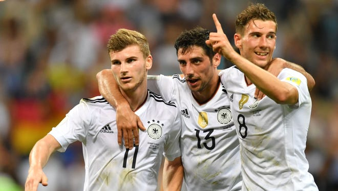 Germany players celebrate a goal against Mexico.