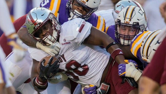 Sep 30, 2017; Baton Rouge, LA, USA; LSU Tigers linebacker Arden Key (49) tackles Troy Trojans running back Jordan Chunn (38) in the first quarter of the game between the LSU Tigers and the Troy Trojans at Tiger Stadium. Mandatory Credit: Stephen Lew-USA TODAY Sports