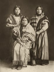 Mollie Burkhart, right, with her sisters Anna, center,