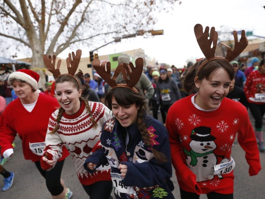 Runners start to race on Dec. 20 during the 5K Reindeer