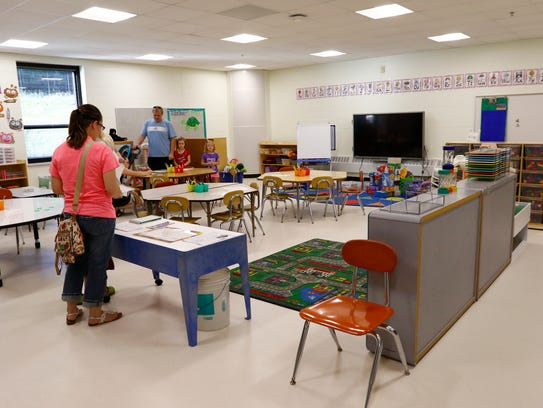 Parents and 4K students tour the classroom during Tuesday's