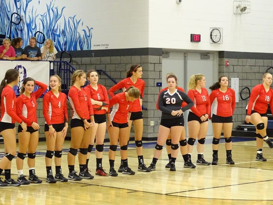 The Buckettes wait for the match to begin against Carey