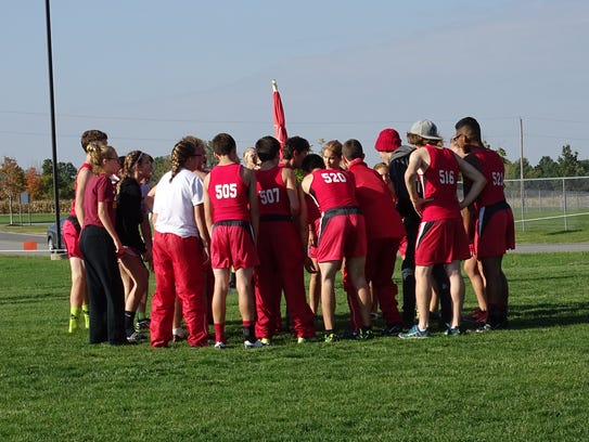 The Bucyrus cross country team huddles together at