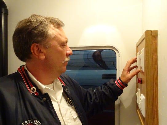 Crestline fire Chief Mike Weisman adjusts controls