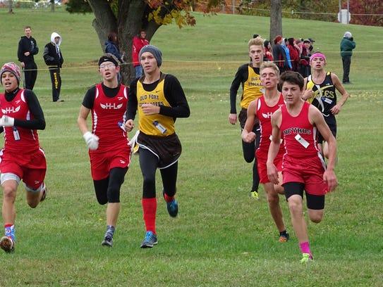 Bucyrus' Zach Hoskins beats out a crowd racing towards