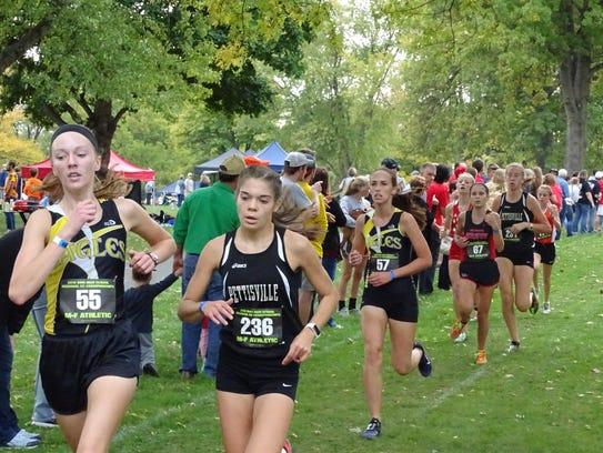 Emily Kemper (No. 55) and Anna Reffey (No. 57) race