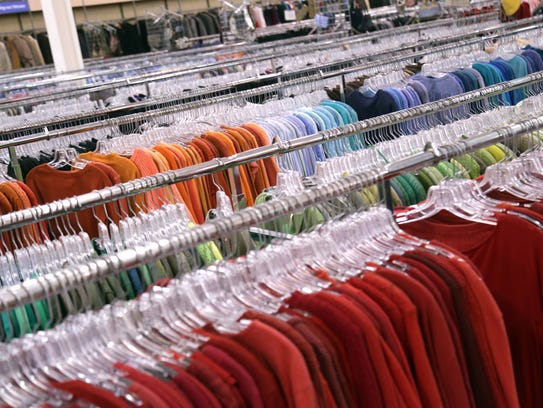 Clothes and household items line the aisles at the