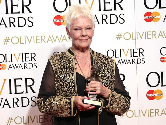 Actress Dame Judi Dench holds her Best Actress in a