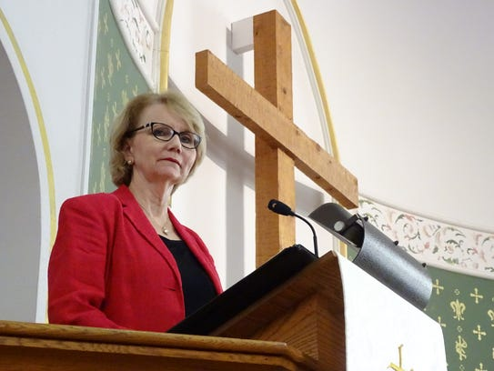 Pastor Renee Ahern smiles from the pulpit just days