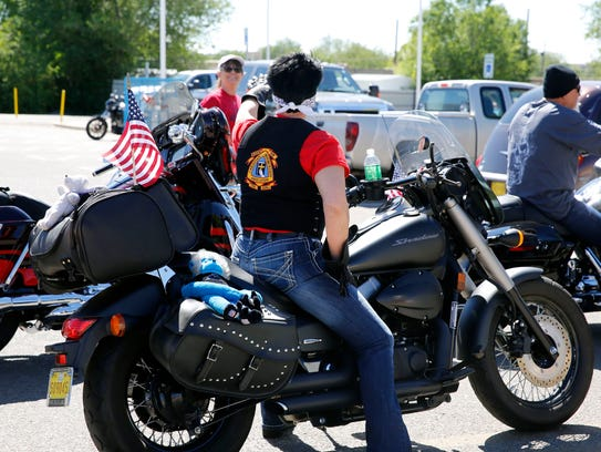 Members of the Christian Motorcycle Association prepare