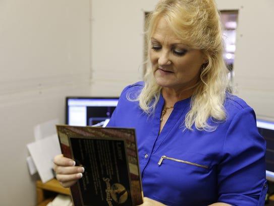 Bonnie Cummings, owner of Third Axis Custom Engraving,